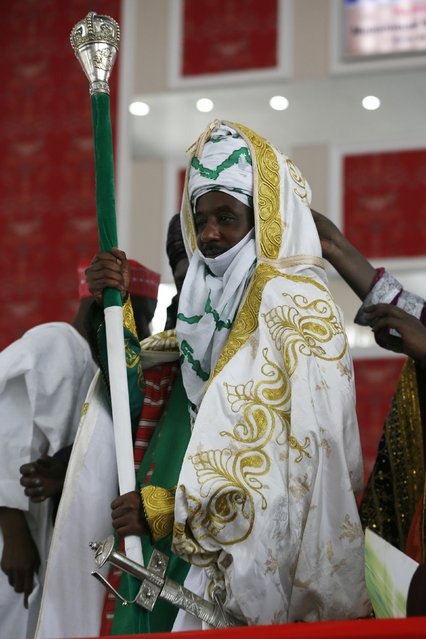 New Emir of Kano Muhamadu Sanusi II holds his staff of office during his coronation in Kano, Kano State, February 7, 2015. (Photo by Afolabi Sotunde/Reuters)