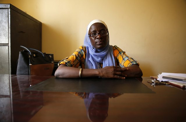 "Adepate Mustapher-Koiki, 43, a Yoruba Muslim woman, who is a lecturer in Mass Communication, sits for a portrait in her office at the University of Lagos January 28, 2015. ""If the issues of killing and bombing are not affecting us now, they are issue that have gotten close to us all. Whoever, emerges should look at the issue of security ... the whole scenario is disturbing our economic growth"", Mustapher-Koiki said. (Photo by Akintunde Akinleye/Reuters)"