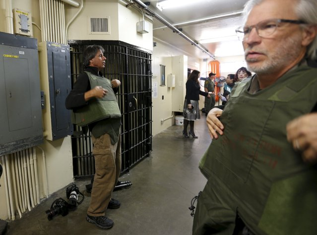 Members of the media put on protective vests prior to entering a row of cells at the Adjustment Center during a media tour of California's Death Row at San Quentin State Prison in San Quentin, California December 29, 2015. (Photo by Stephen Lam/Reuters)