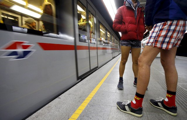 People stand on a train platform during the 'No Pants Subway Ride' in Vienna, Austria, January 10, 2016. (Photo by Heinz-Peter Bader/Reuters)