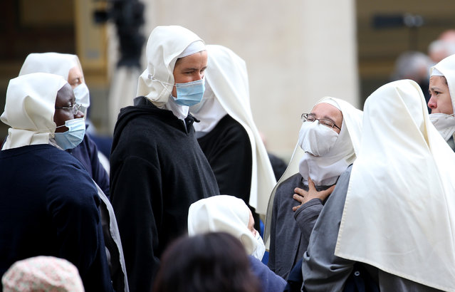 Nuns attend Pope Francis' weekly General Audience in the Courtyard of St Damasus on May 12, 2021 in Vatican City, Vatican. Pope Francis recalled the attack on St Pope John Paul II 40 years ago, the liturgical feast of Our Lady of Fatima and he invited the faithful to recite the Holy Rosary for the end of the pandemic. (Photo by Franco Origlia/Getty Images)