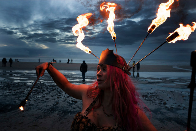 Penella Bee marks the autumn equinox at Druridge Bay in Northumberland, UK on September 23, 2018, before the annual north-east skinny dip, which raises money for the mental health charity Mind. (Photo by Owen Humphreys/PA Wire)