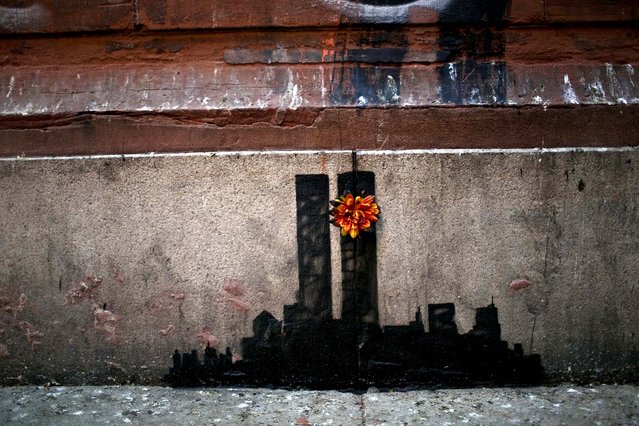 A work of art by Banksy commemorating the 9/11 attacks is seen on a wall in lower Manhattan, October 15, 2013. (Photo by Kirsten Luce/The New York Times)