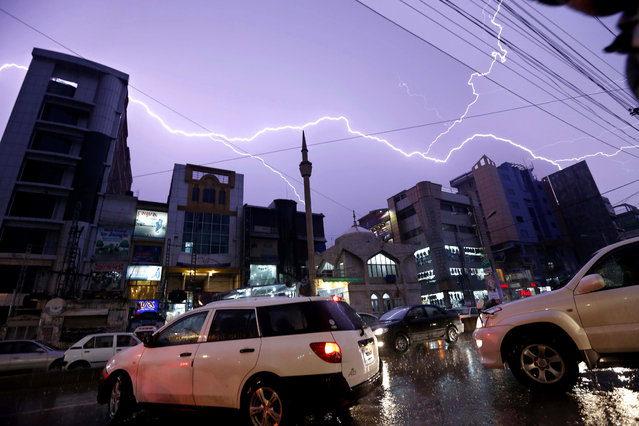 A lightning illuminates the dark sky over during a rainy day with thunderstorm in Peshawar, Pakistan, 26 February 2021. Khyber Pakhtunkhwa are expected to receive substantial rain during this time, according to the weather department. The southern areas of Sindh, according to the Met department, will also receive light to moderate rainfall due to the system. (Photo by Bilawal Arbab/EPA/EFE)