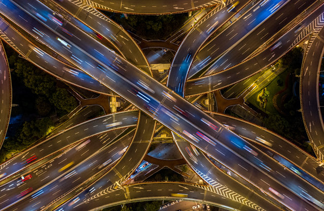 This aerial picture taken on the night of November 12, 2018 shows traffic on an elevated intersection in downtown Shanghai, China. (Photo by Johannes Eisele/AFP Photo)