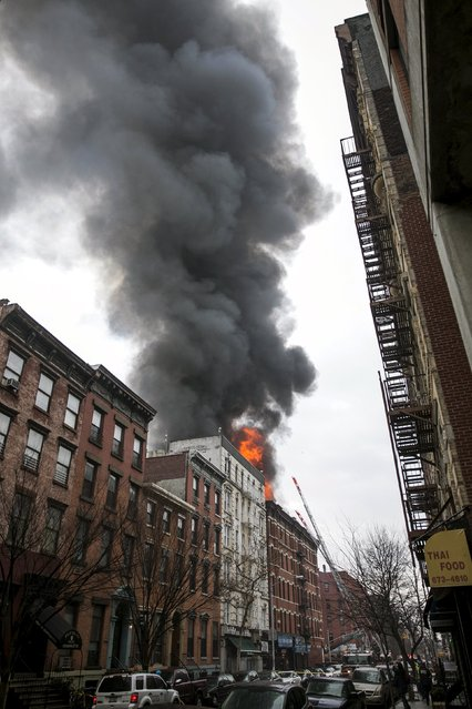 Flames rise from a building fire in the East Village neighborhood of New York City on March 26, 2015. (Photo by Ben Hider/Reuters)