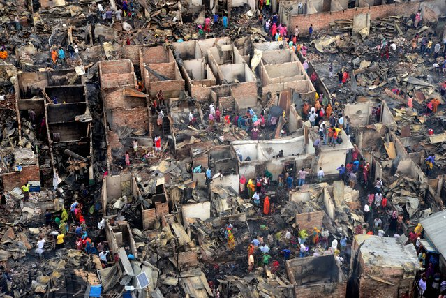 Photo taken on June 7, 2021 shows the burned-out section of one of the largest slums in Bangladeshi capital Dhaka. A devastating fire swept through one of the largest slums in Dhaka, destroying at least 100 shanties on early Monday. No casualty has been reported so far. (Photo by Xinhua News Agency/Imago)