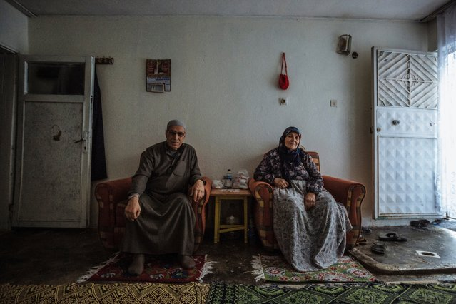 Hamdo and Hamadi are an elderly Syrian refugee couple from Aleppo. During the early years of the conflict, they decided to move back to their village in the countryside once the bombs started dropping in the city centre, where their four children and their families lived. While safe for a short time, a rocket eventually hit their home, killing their son, Ali, and his entire family. Their deaths pushed them finally to leave Syria and flee to Turkey with their three remaining children. They have been living there for the past three-and-a-half years. (Photo by Muse Mohammed/IOM)