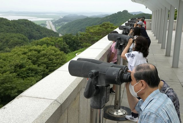 Visitors watch the North Korea side from the Unification Observation Post in Paju South Korea, near the border with North Korea, Thursday, June 17, 2021. The North Korea's official Korean Central News Agency said Wednesday that North Korean leader Kim Jong Un on warned about possible food shortages and urged the country to brace for extended COVID-19 restrictions as he opened a major political conference to discuss national efforts to salvage a broken economy. (Photo by Ahn Young-joon/AP Photo)