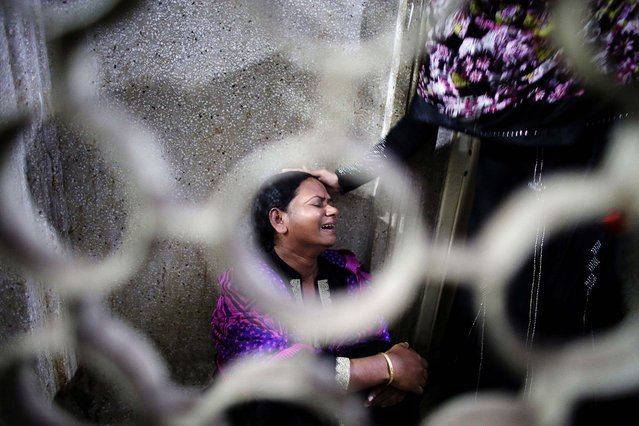 Nasima cries after her mother Monowara Begum, 55, was injured by a crude bomb, at Dhaka Medical College Hospital in Bangladesh, on November 26, 2013. Opposition supporters detonated scores of homemade bombs and removed railway tracks to disrupt train services on Tuesday as a planned nationwide protest against upcoming elections turned violent. (Photo by Andrew Biraj/Reuters)