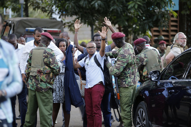 Kenyan arm forces rescue people after an attack on a hotel, in Nairobi, Kenya, Tuesday, January 15, 2019.  Extremists launched a deadly attack on a luxury hotel in Kenya's capital Tuesday, sending people fleeing in panic as explosions and heavy gunfire reverberated through the complex. (Photo by Brian Inganga/AP Photo)