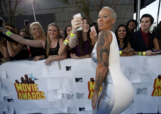 Model Amber Rose arrives at the 2015 MTV Movie Awards in Los Angeles, California April 12, 2015. (Photo by Mario Anzuoni/Reuters)