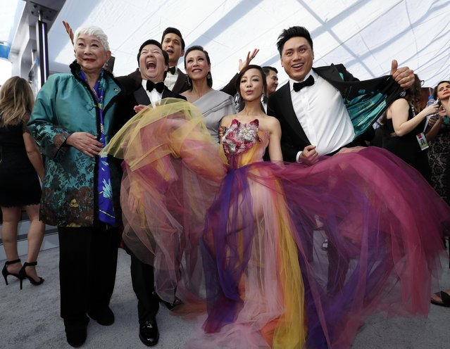 """Cast members of """"Crazy Rich Asians"""" arrive at the 25th annual Screen Actors Guild Awards at the Shrine Auditorium & Expo Hall on Sunday, January 27, 2019, in Los Angeles. (Photo by Mario Anzuoni/Reuters)"""