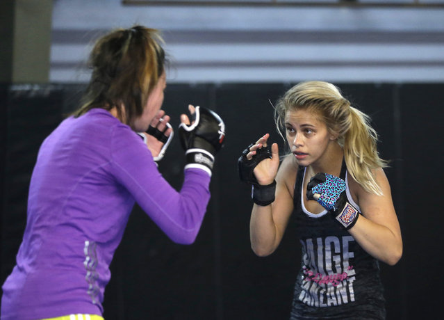 In this Monday, April 13, 2015, photo, mixed martial arts fighter Paige VanZant, right, spars with Sarah Jamila at Ultimate Fitness in Sacramento, Calif. (Photo by Rich Pedroncelli/AP Photo)