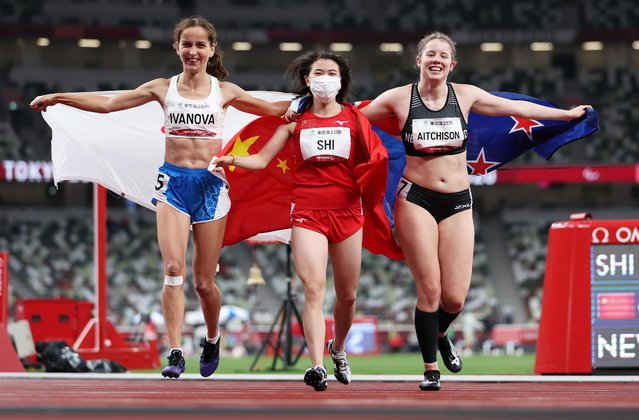 Silver medallist Russia's Elena Ivanova (L), gold medallist China's Shi Yiting and bronze medallist New Zealand's Danielle Aitchison celebrate after the women's 100m T36 final at the Tokyo 2020 Paralympic Games at the Olympic Stadium in Tokyo on September 1, 2021. (Photo by Molly Darlington/Reuters)
