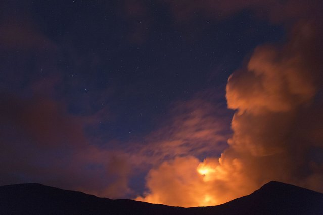 Smoke billows from the Plosky Tolbachik volcano. (Photo by Denis Budkov/Caters News)