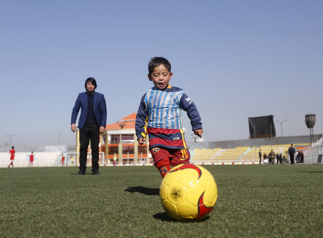 Five year-old Murtaza Ahmadi wears a shirt of Barcelona's star Lionel Messi made of a plastic bag as he plays soccer at the Afghan Football Federation headquarters in Kabul, Afghanistan February 2, 2016. (Photo by Omar Sobhani/Reuters)