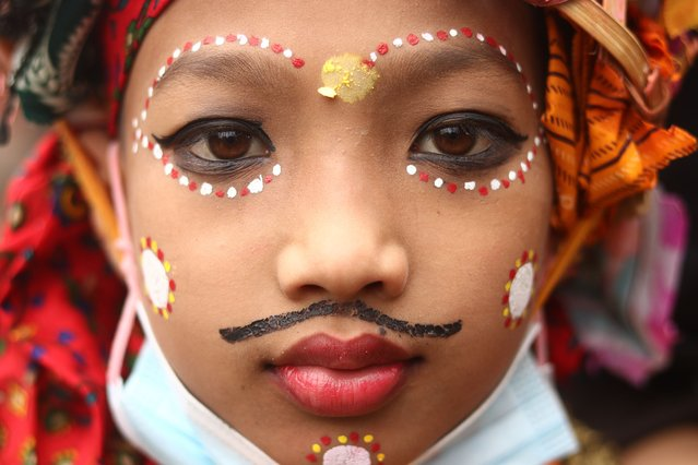 A child with facial makeup participates in the annual Gai Jatra festival in Kathmandu, Nepal on August 23, 2021. (Photo by Aryan Dhimal/ZUMA Press Wire/Rex Features/Shutterstock)