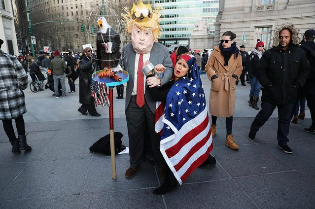 Protesters pause while attending arally in lower Manhattan to protest President Donald Trump's new immigration policies on January 29, 2017 in New York City. Trump's executive order on immigration has created chaos and confusion among many Muslims as it temporarily bars citizens from seven largely Muslim countries, as well as all refugees, from entering the U.S. (Photo by Spencer Platt/Getty Images)