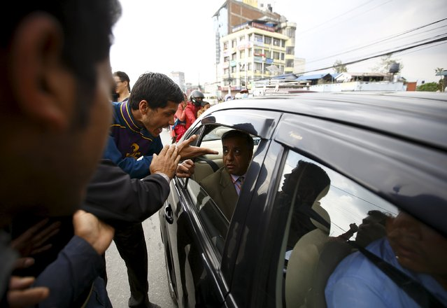 An earthquake victim shouts at a government official as they block traffic along a road while protesting against the government's lack of aid provided to the victims in Kathmandu, Nepal April 29, 2015. (Photo by Navesh Chitrakar/Reuters)