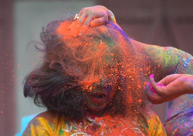Girls seen playing with colors on the festive day of Holi on March 20, 2019 in Agartala, Tripura. India. (Photo by Abhisek Saha/Barcroft Images via Getty Images)