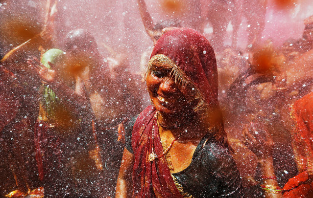 A woman takes part in Huranga, a game played between men and women a day after Holi, at Dauji temple near the northern city of Mathura, India March 22, 2019. (Photo by Adnan Abidi/Reuters)