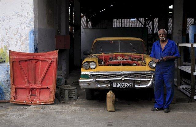 Alejandro, 62, a private mechanic, repairs his 1958 Ford car in Havana February 29, 2016. (Photo by Enrique de la Osa/Reuters)