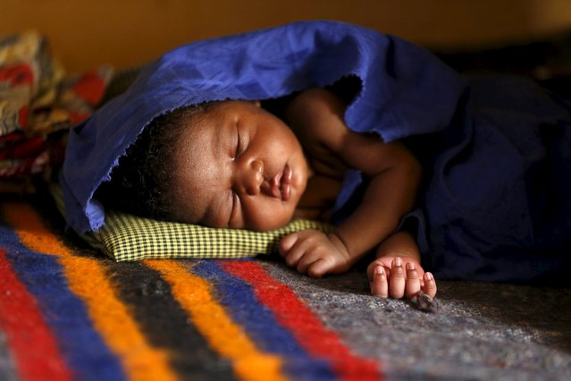 A baby born in captivity to one of the women rescued from Boko Haram in Sambisa forest sleeps at a clinic at the Internally Displaced People's camp in Yola, Nigeria May 3, 2015. (Photo by Afolabi Sotunde/Reuters)
