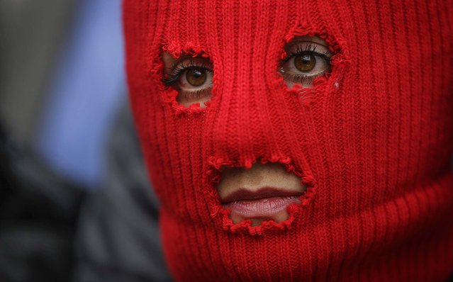 A member of the p*ssy Riot punk group – who have feuded with Vladmir Putin's government for years – looks on during a press conference in Sochi, Russia, on February 20, 2014. (Photo by David Goldman/Associated Press)