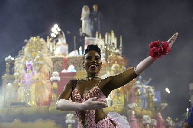 A dancer from the Rosas de Ouro samba school performs during a carnival parade in Sao Paulo, Brazil, Saturday, March 1, 2014. (Photo by Andre Penner/AP Photo)