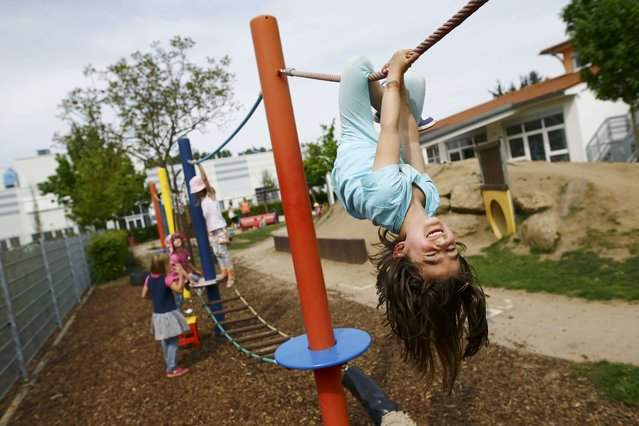 Children play in the garden of their kindergarten run by a private foundation which is not affected by the nursery caretakers' strike in Hanau, 30km south of Frankfurt, Germany, May 11, 2015. Most of the kindergartens run by public services all over Germany face a strike of the nursery caretakers as they fight for higher wages and better working conditions. (Photo by Kai Pfaffenbach/Reuters)