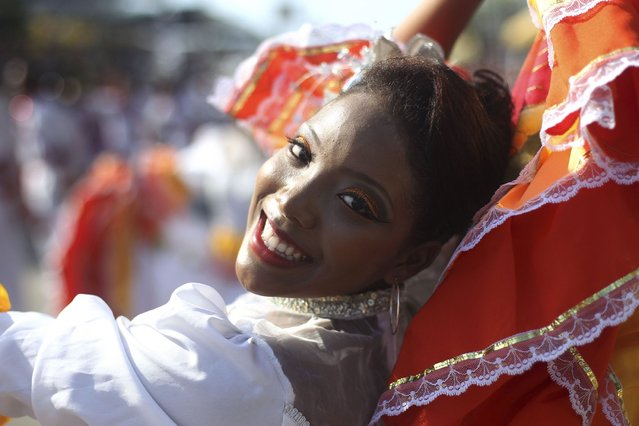"""Congo dancers perform during the """"Grand Parade of Tradition"""" as part of Carnival celebrations in Barranquilla, on March 1, 2014. (Photo by John Vizcaino/Reuters)"""