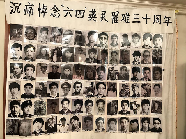 """This handout photograph taken in March 2019, and released on May 29, 2019 by the Tiananmen Mothers via Human Rights in China, shows portraits of people who were killed in the June 4, 1989 crackdown on pro-democracy protests in Beijing, at a secret meeting in an undisclosed location in China. Members of the Tiananmen Mothers, a group seeking answers about the June 4, 1989 crackdown, on May 29, 2019 released a video and photos of an underground tribute for relatives who died during the brutal repression of the pro-democracy protests. The Chinese characters at top read """"With deep sadness we commemorate the brave souls of June 4, who died 30 years ago"""". (Photo by AFP Photo/Stringer)"""