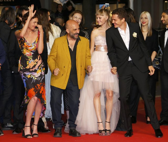 """(L-R) Cast member Aomi Muyock, director Gaspar Noe, cast members Klara Kristin and Karl Glusman pose on the red carpet as they arrive for the screening of the film """"Love"""" out of competition at the 68th Cannes Film Festival in Cannes, southern France, May 20, 2015. (Photo by Yves Herman/Reuters)"""