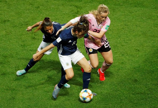 Argentina's Vanesa Santana and Ruth Bravo in action with Scotland's Erin Cuthbert during the 2019 FIFA Women's World Cup France group D match between Scotland and Argentina at Parc des Princes stadium on June 19, 2019 in Paris, France. (Photo by Gonzalo Fuentes/Reuters)