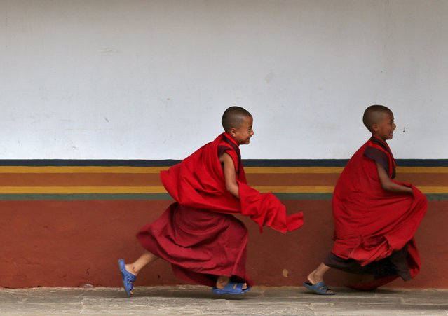 Young monks play inside the Punakha Dzong, Bhutan, April 17, 2016. (Photo by Cathal McNaughton/Reuters)