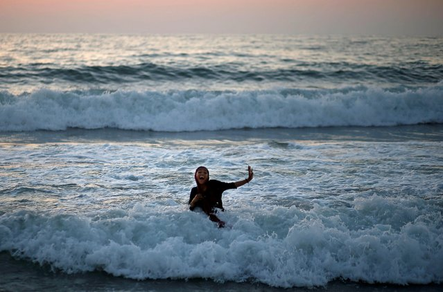 A Palestinian woman swims in the Mediterranean Sea in the northern Gaza Strip on July 9, 2019. (Photo by Mohammed Salem/Reuters)