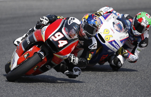 Moto2 rider Jonas Folger steers his bike during the Moto 2 third free practice session for the motorcycle GP in Montmelo, Spain, Saturday, June 13, 2015.  The Catalunya Grand Prix will take place on Sunday in Montmelo. (AP Photo/Manu Fernandez)