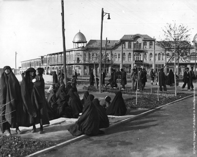 1950:  The central square of Hamadan where veiled women gather together