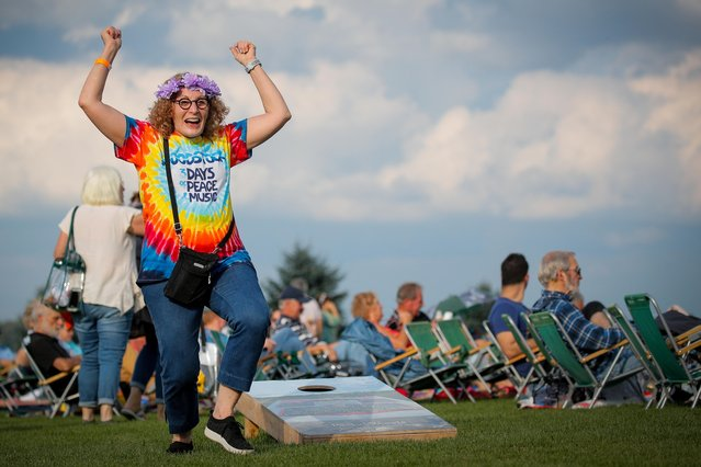 Guests arrive for the Arlo Guthrie concert at the Bethel Woods Center for the Arts, the original site of the Woodstock Festival, on the 50th anniversary in Bethel, New York, U.S. August 15, 2019. (Photo by Brendan McDermid/Reuters)