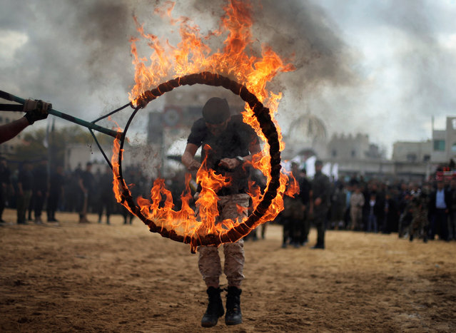 A Palestinian jumps through a ring of fire during a military exercise graduation ceremony organized by Palestinian national security forces loyal to Hamas, in Gaza City April 2, 2016. (Photo by Mohammed Salem/Reuters)