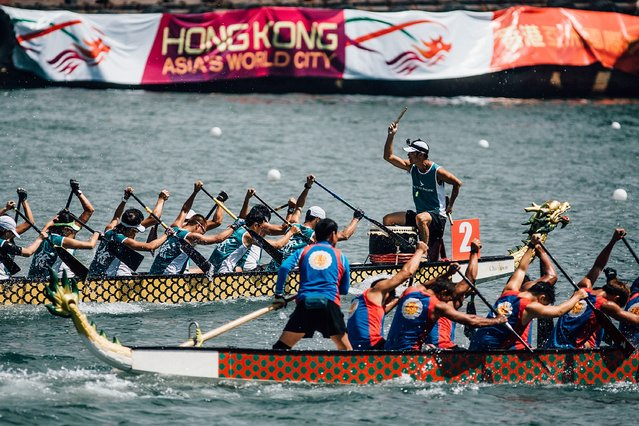 Competitors paddle their boats during the Hong Kong Dragon Boat Carnival Race on July 5, 2015 in Hong Kong, Hong Kong. (Photo by Taylor Weidman/Getty Images for Hong Kong Images)