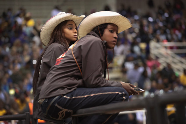 Justine Carter (L) chats with her cousin Dana Carter as they kill time between events at the Bill Pickett Invitational Rodeo on March 31, 2017 in Memphis, Tennessee. (Photo by Scott Olson/Getty Images)