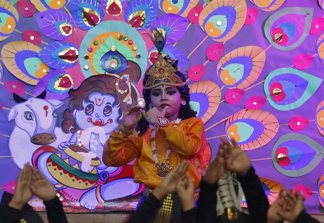 A girl dressed up as Hindu Lord Krishna performs in a cultural event to mark the festival of Janmashtami, or the birth anniversary of Hindu Lord Krishna, inside a school in Kolkata, August 22, 2019. (Photo by Rupak De Chowdhuri/Reuters)