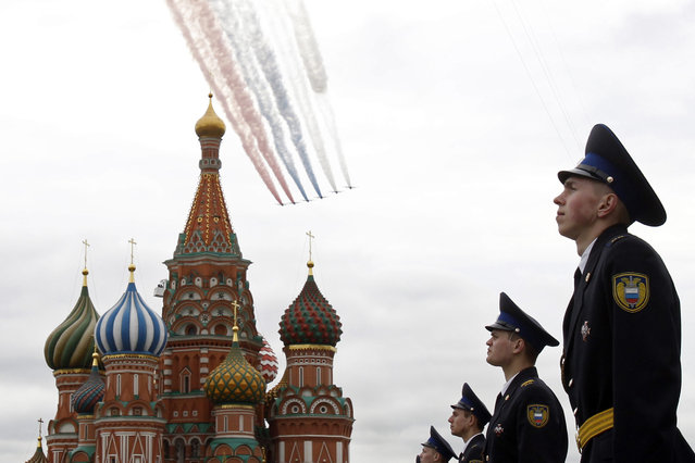 Red Square and the Kremlin: Russian fighter jets fly in formation over Red Square and the Kremlin during a military parade dress rehearsal in Moscow May 6, 2010. (Photo by Denis Sinyakov/Reuters)