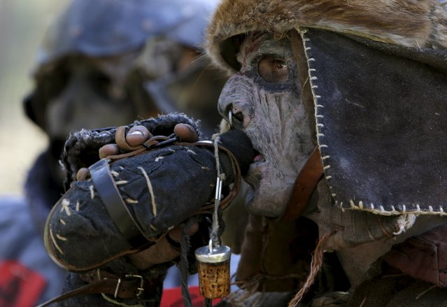 """A participant drinks during the reenactment the """"Battle of Five Armies"""" from J.R.R. Tolkien's novel """"The Hobbit"""" in a forest near the town of Doksy, Czech Republic June 6, 2015. (Photo by David W. Cerny/Reuters)"""