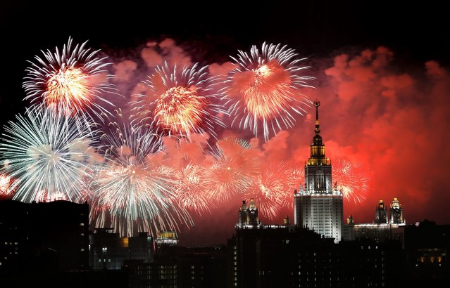 Fireworks illuminates the evening sky over Moscow's University building in Moscow, Russia, 09 May 2016. Russia celebrates the 71st anniversary of the victory over Nazi Germany in World War II. (Photo by Yuri Kochetkov/EPA)