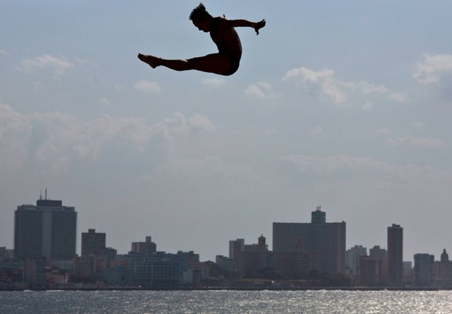 An athlete dives from Red Bull Cliff Diving World Series platform during a training session in Havana, Cuba, Thursday, May 8, 2014. The first competition of the 2014 Red Bull Cliff Diving World Series Championship will be on Saturday May 10, when the world's best cliff divers will jump from the 27-metre platform positioned on the historic Morro Castle in Havana. (Photo by Ramon Espinosa/AP Photo)