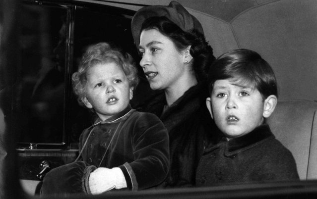 Prince Charles, with his mother, Queen Elizabeth II and his sister, Princess Anne, left, as they sit in an automobile following their arrival in London, February 9, 1953, by train from a six-week Christmas vacation at Sandringham,England. (Photo by AP Photo)