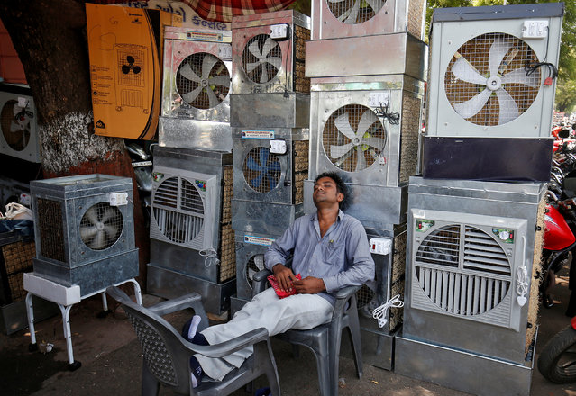 A man selling air coolers rests at a market on a hot summer day in Ahmedabad, India May 4, 2017. (Photo by Amit Dave/Reuters)
